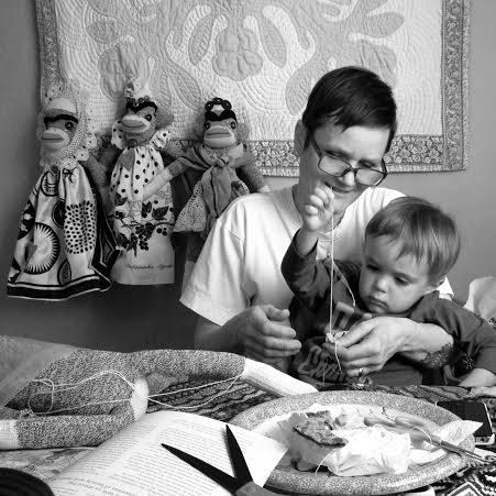 Teaching my nephew Henrik how to sew.  Photo by Darcy Glip.