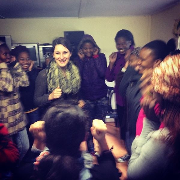 """@vrybalka leading warm up this morning for @globalsorority #southafrica"" - Loretta Cella"